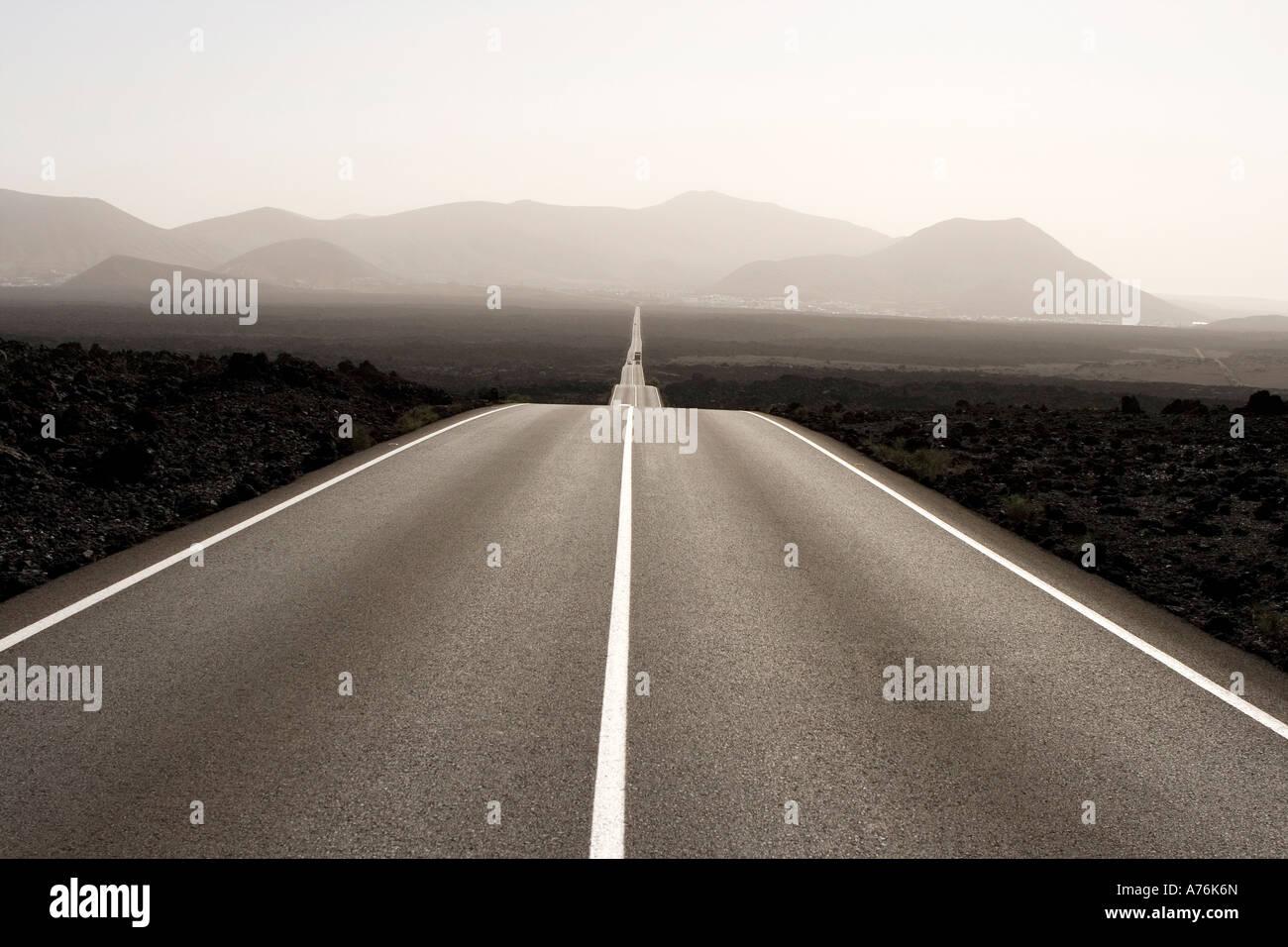 Spain, Lanzarote, empty road through landscape - Stock Image