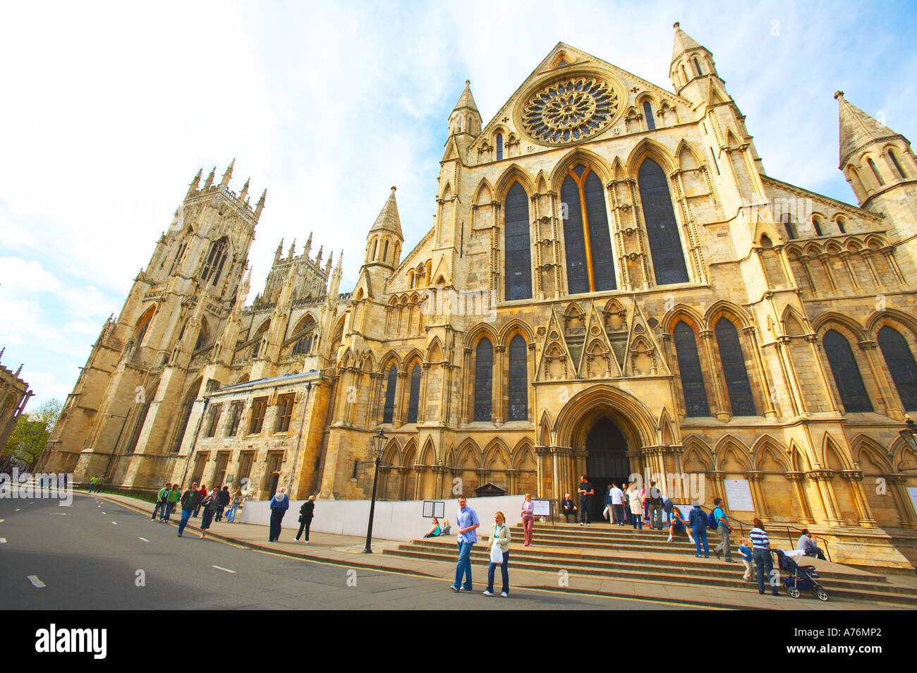 Extreme view of the splendid York Minster with tourists - Stock Image