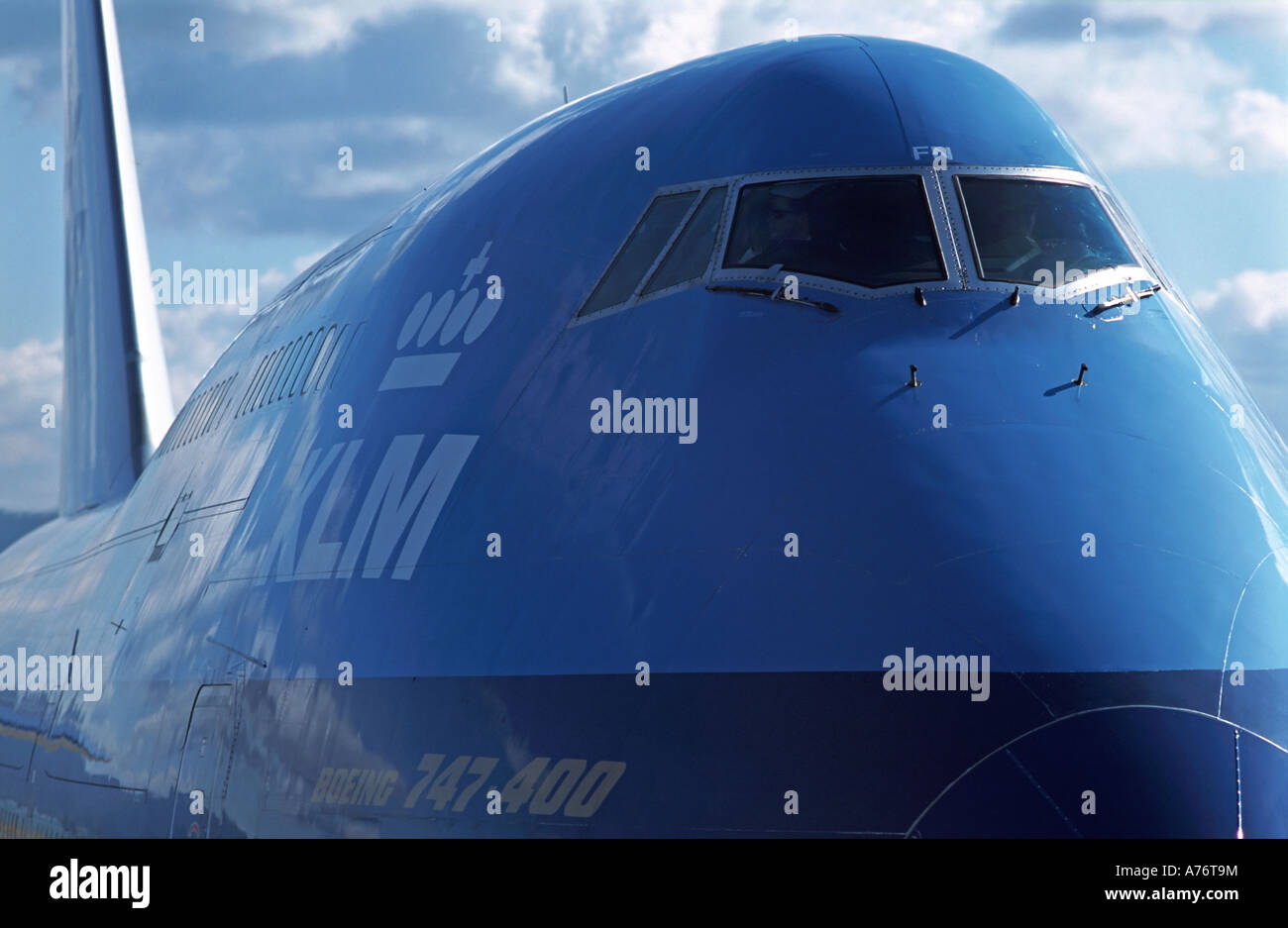 Boeing 747 400 cockpit viewed from the nose KLM livery on the side - Stock Image