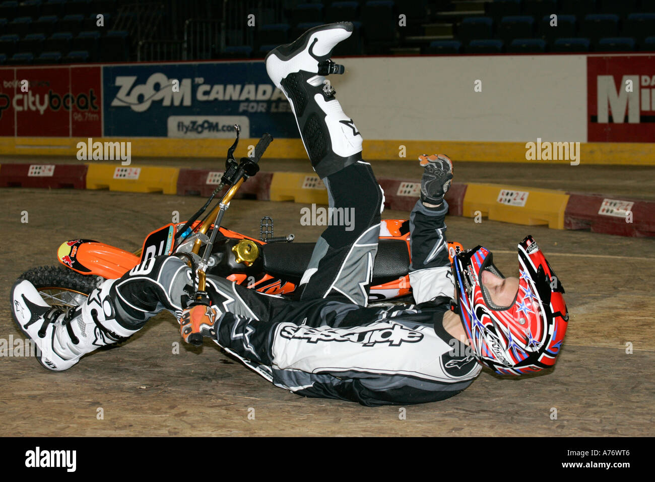 jeremy mcwilliams falls off his minibike at the launch of the indoor motocross Odyssey Arena Belfast Northern Ireland - Stock Image