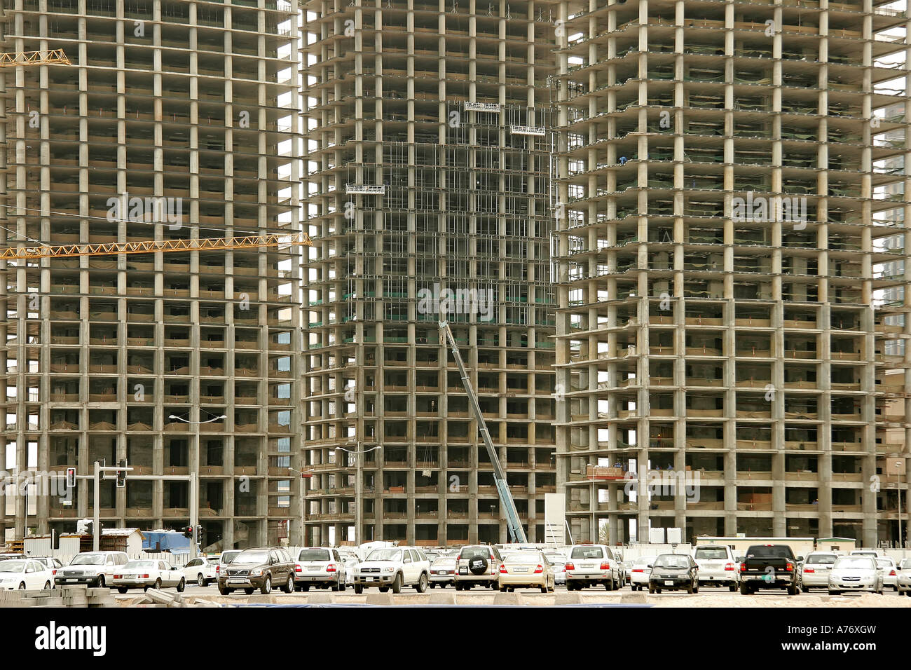 Carcass of three high-rise buildings with parking lot in front, Doha, Qatar, United Arab Emirates - Stock Image
