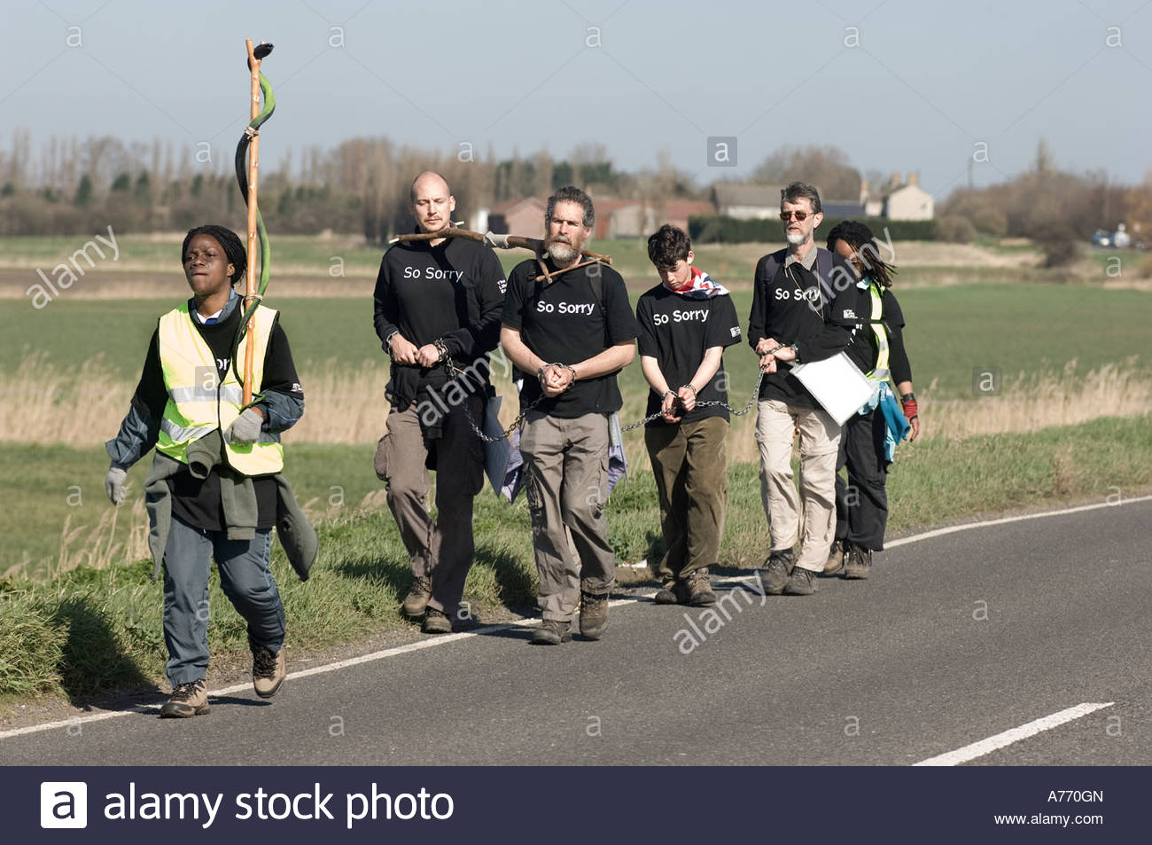 christians on a pilgrimage carrying a cross in rememberance of slavery - Stock Image