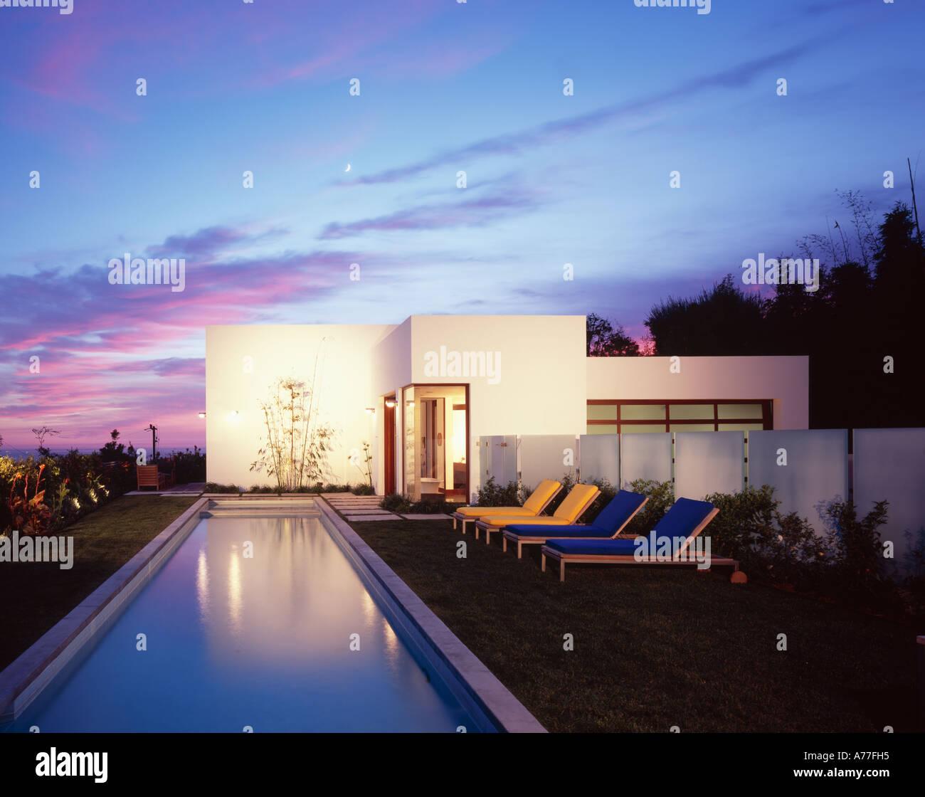 Malibu 4,  California. lengths swimming pool at dusk. Architect: Kanner Architects - Stock Image