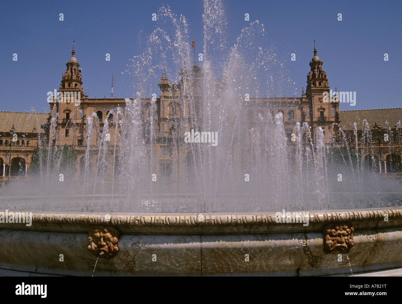 a fountain beyond the Palacio Espanol in Plaza de Espana Sevilla Andalusia Spain - Stock Image