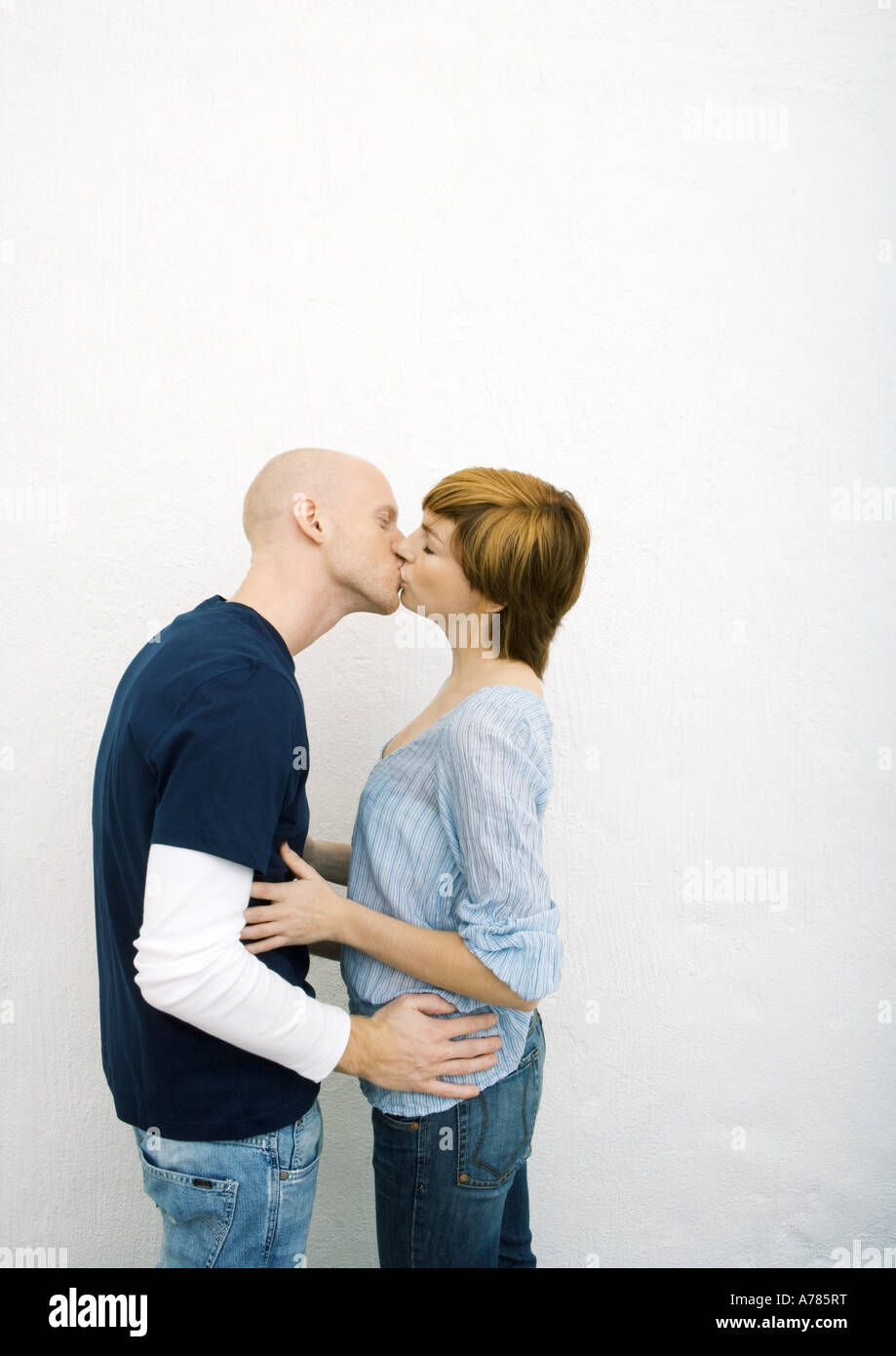 Young Couple Kissing Hands On Each Others Waists Stock Image