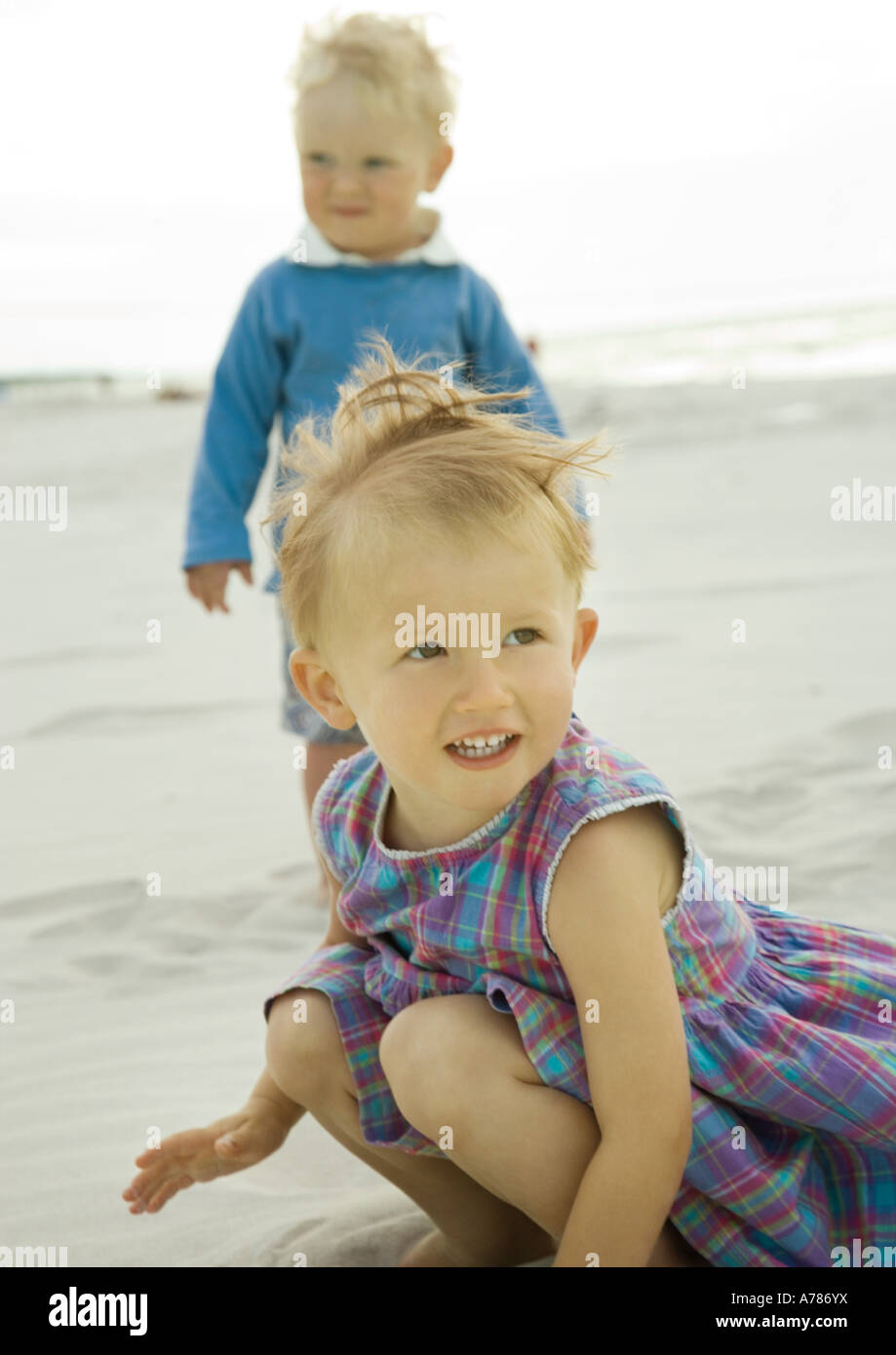 Two toddlers on beach - Stock Image