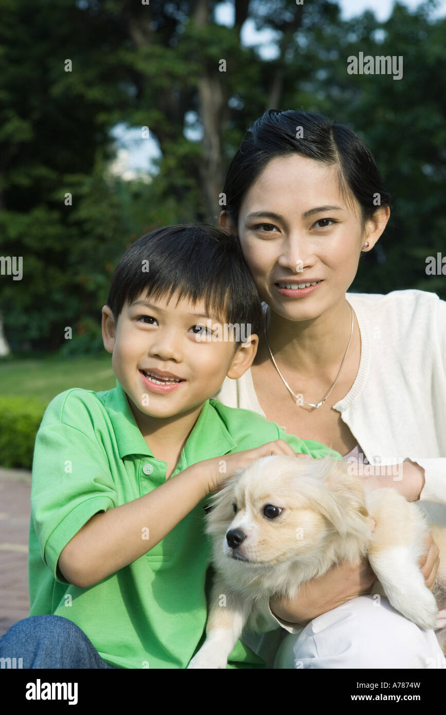 Mother and son with dog, portrait - Stock Image