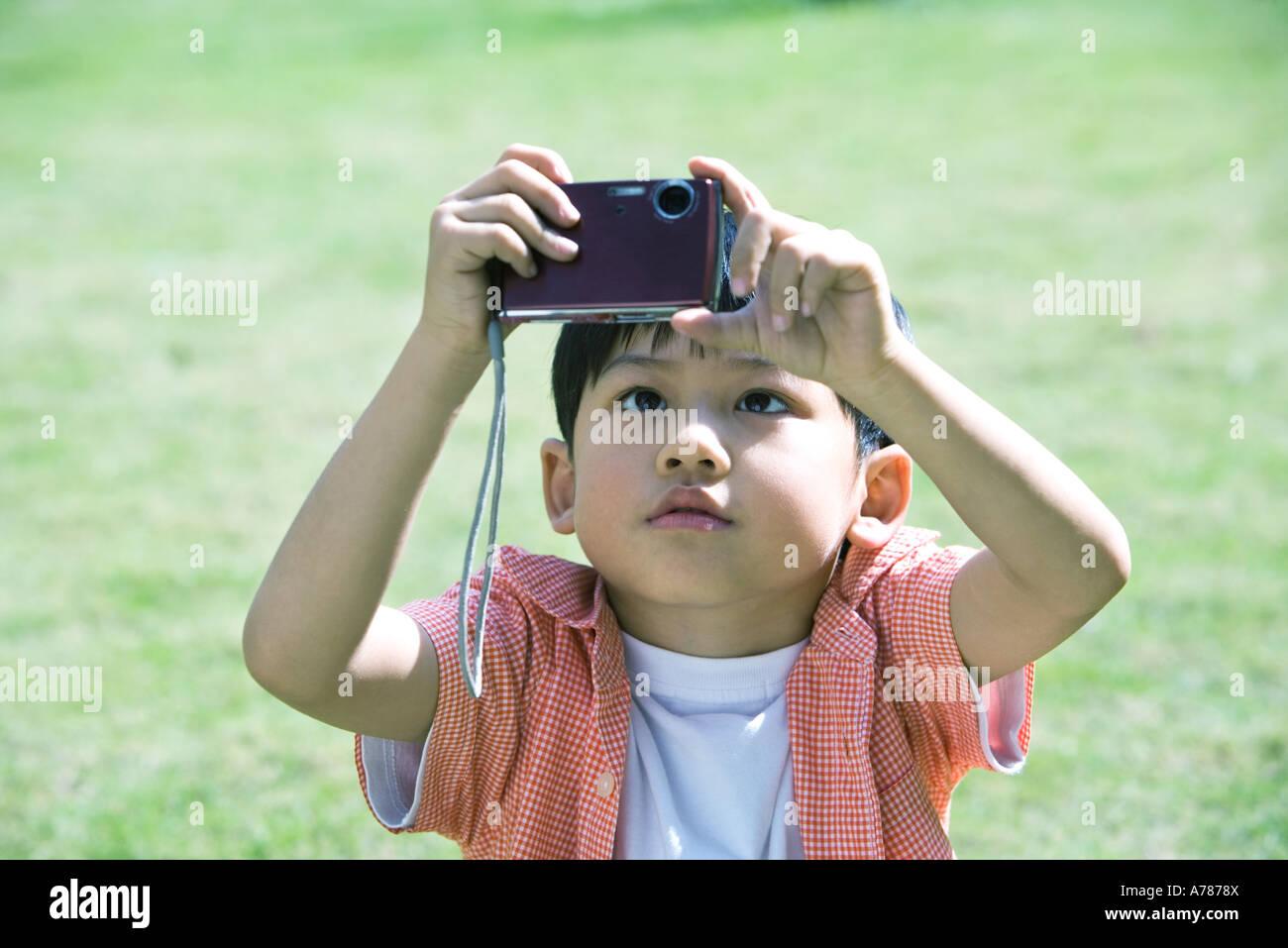 Boy using digital camera - Stock Image