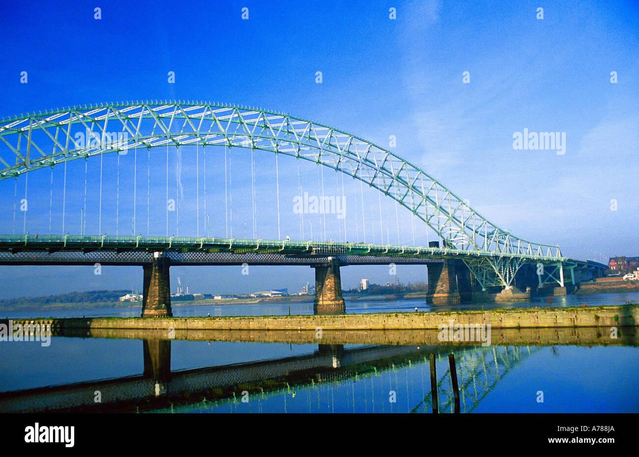 Runcorn-Widnes Road Bridge (The Silver Jubilee Bridge) from Runcorn Promenade, Winter 2005 - Stock Image