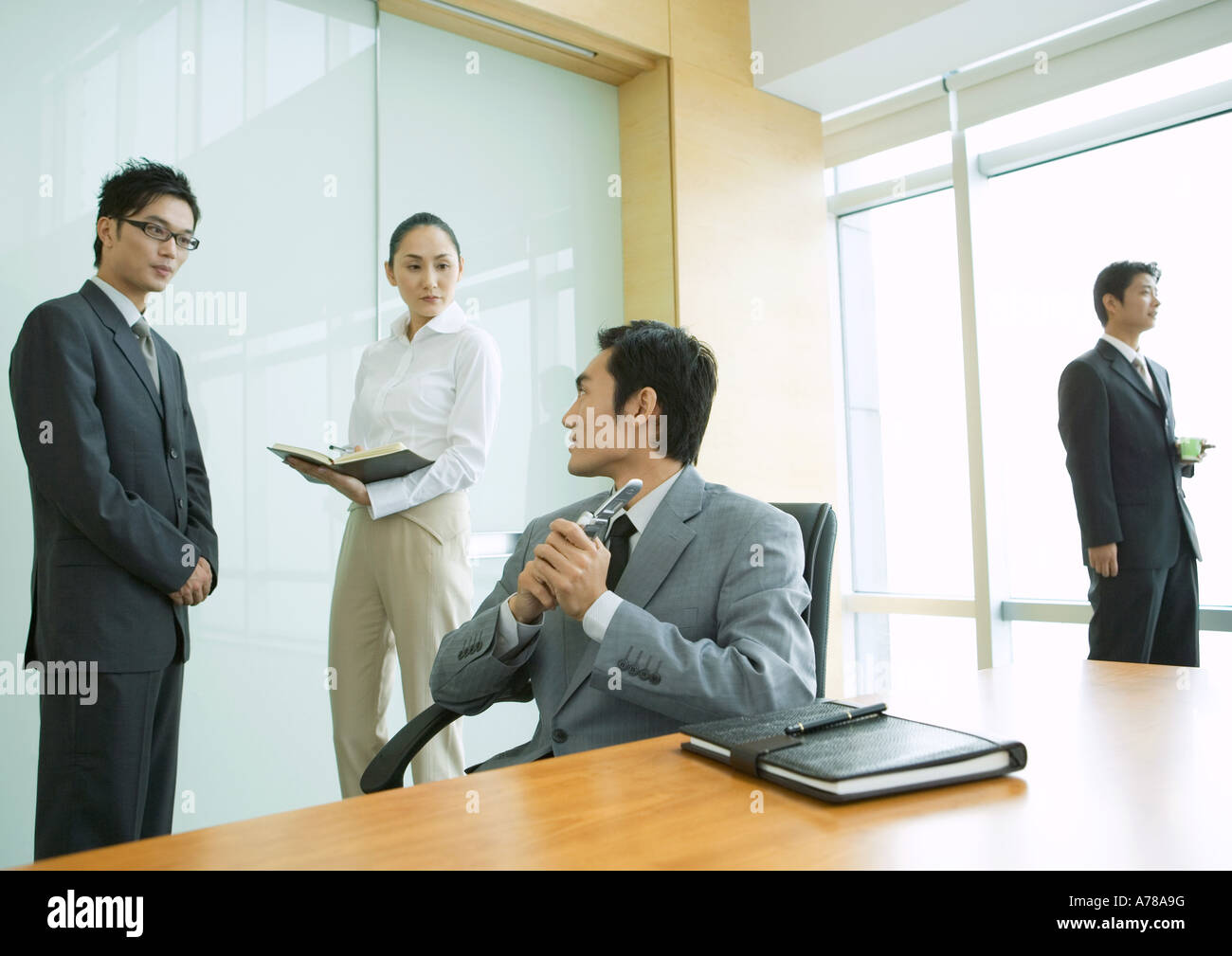 Business executives working in office - Stock Image