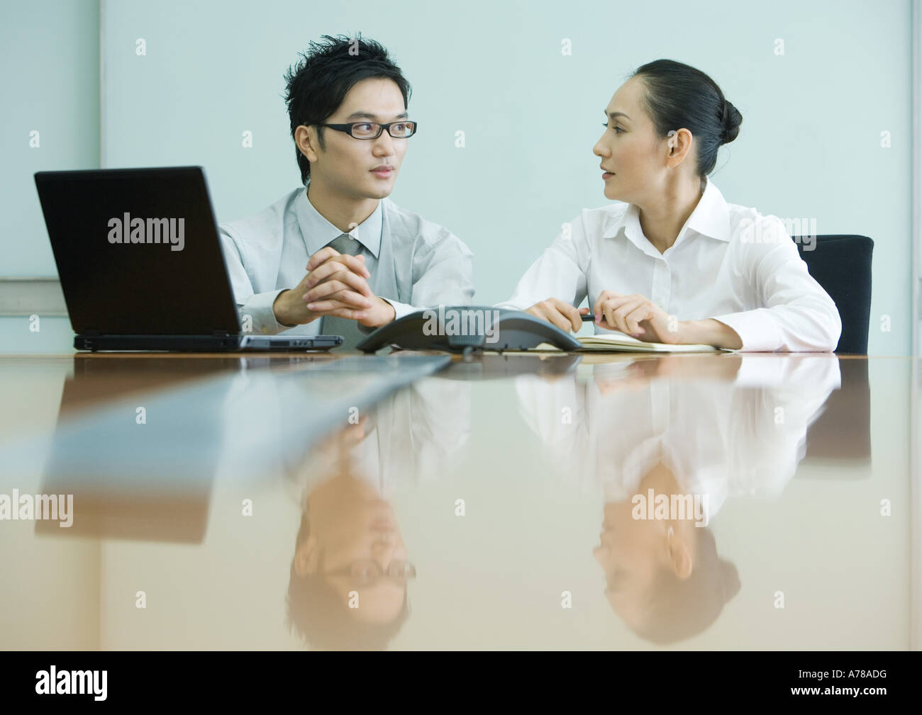 Business executives working in conference room - Stock Image