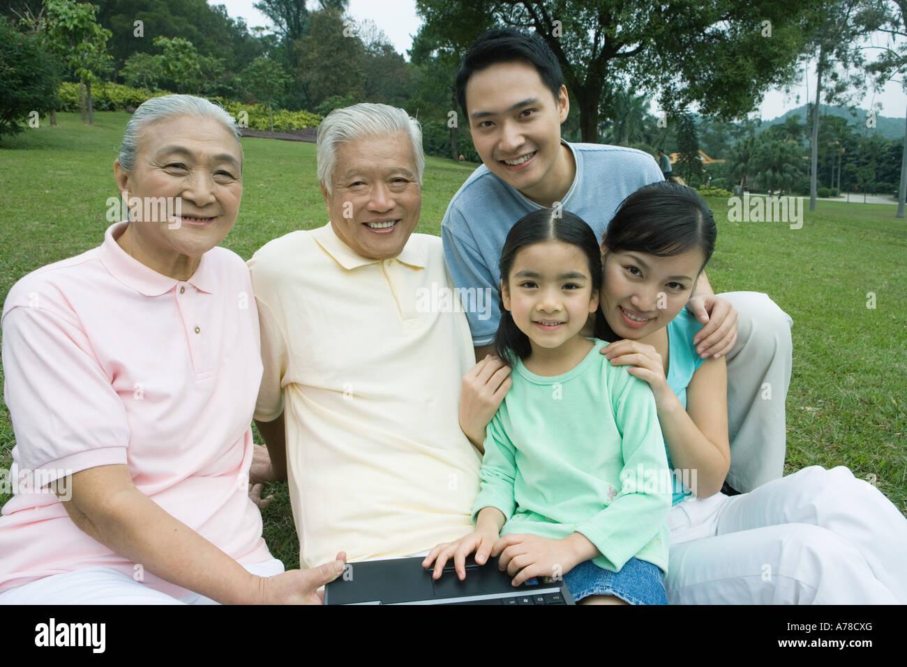 Three generation family, smiling at camera Stock Photo