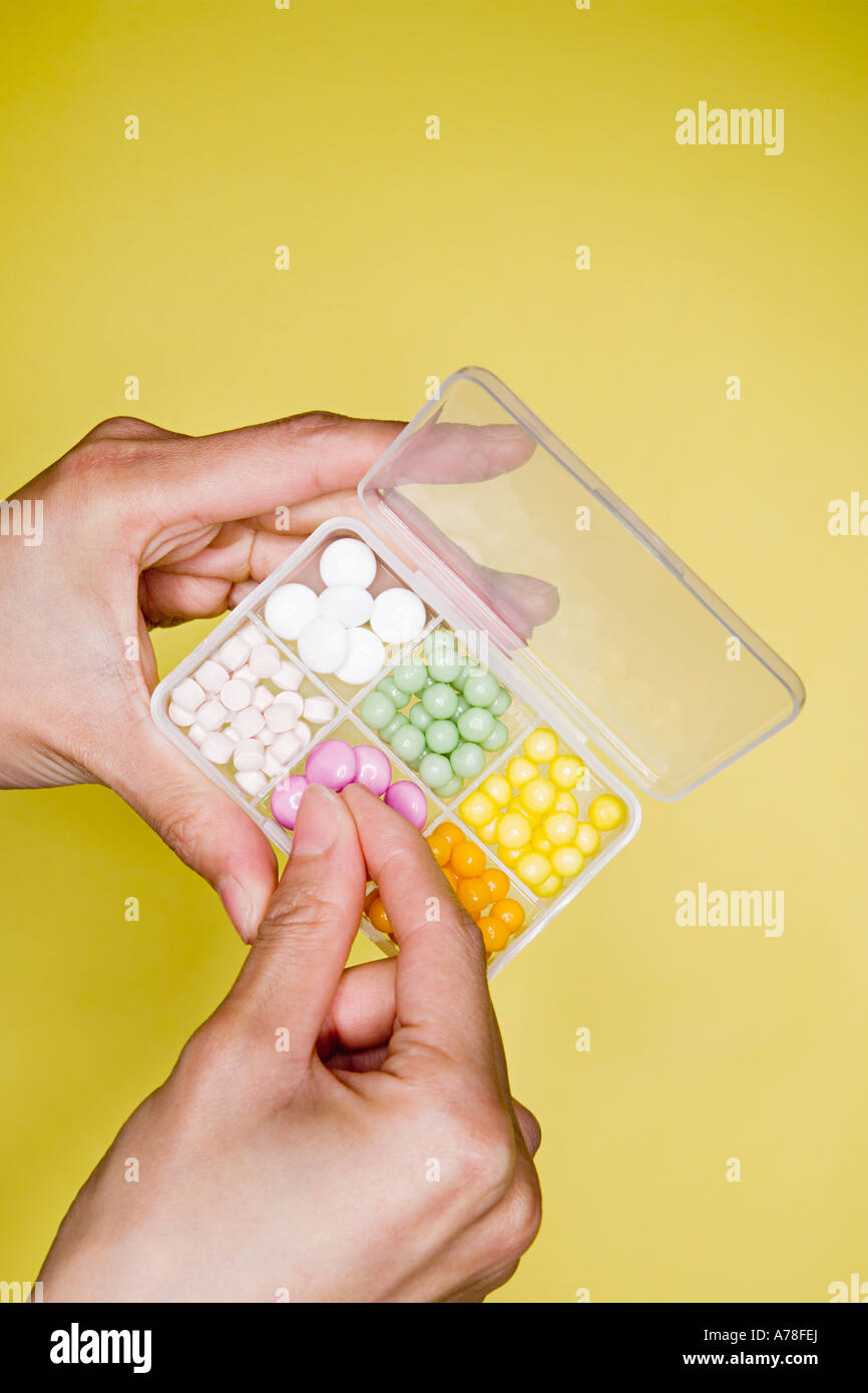 Person with box of tablets - Stock Image