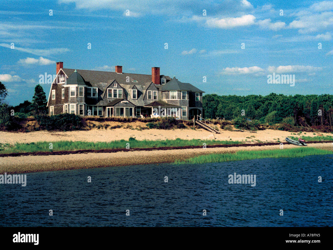 An old holiday home of a wealthy Boston family standing in neglected grounds on the Cape Cod coast ( no longer in existence ) - Stock Image