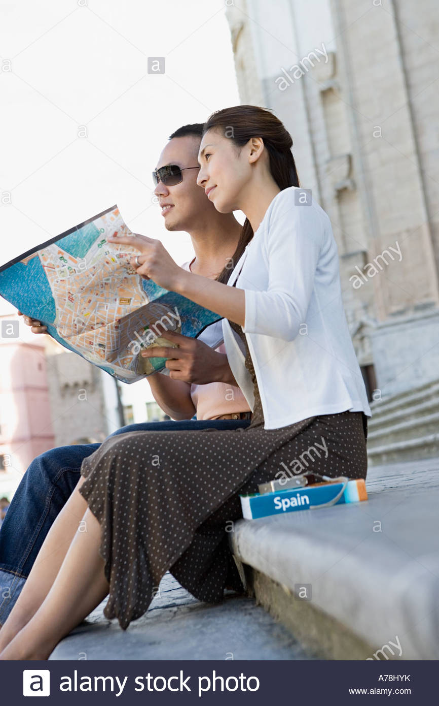 Couple holding map - Stock Image