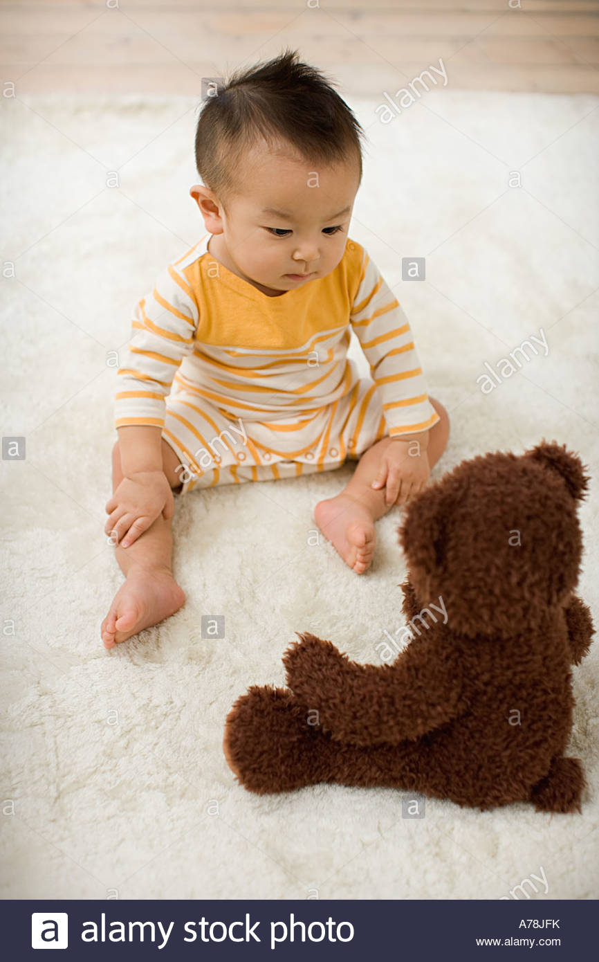 Baby boy with teddy bear - Stock Image