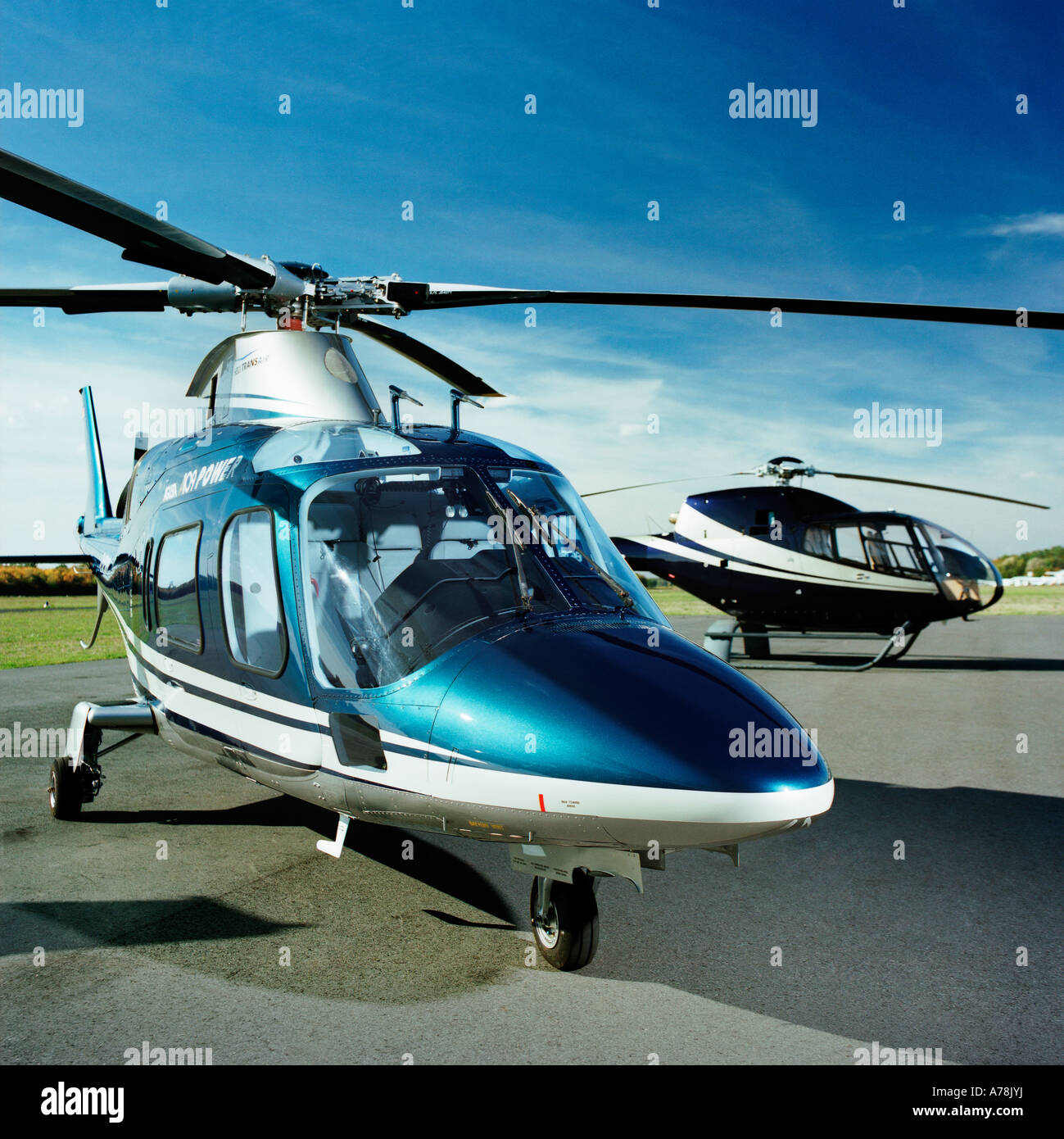 Two helicopters on manoeuvring area one Agusta A 109 E Power one Colibri  Eurocopter EC 120