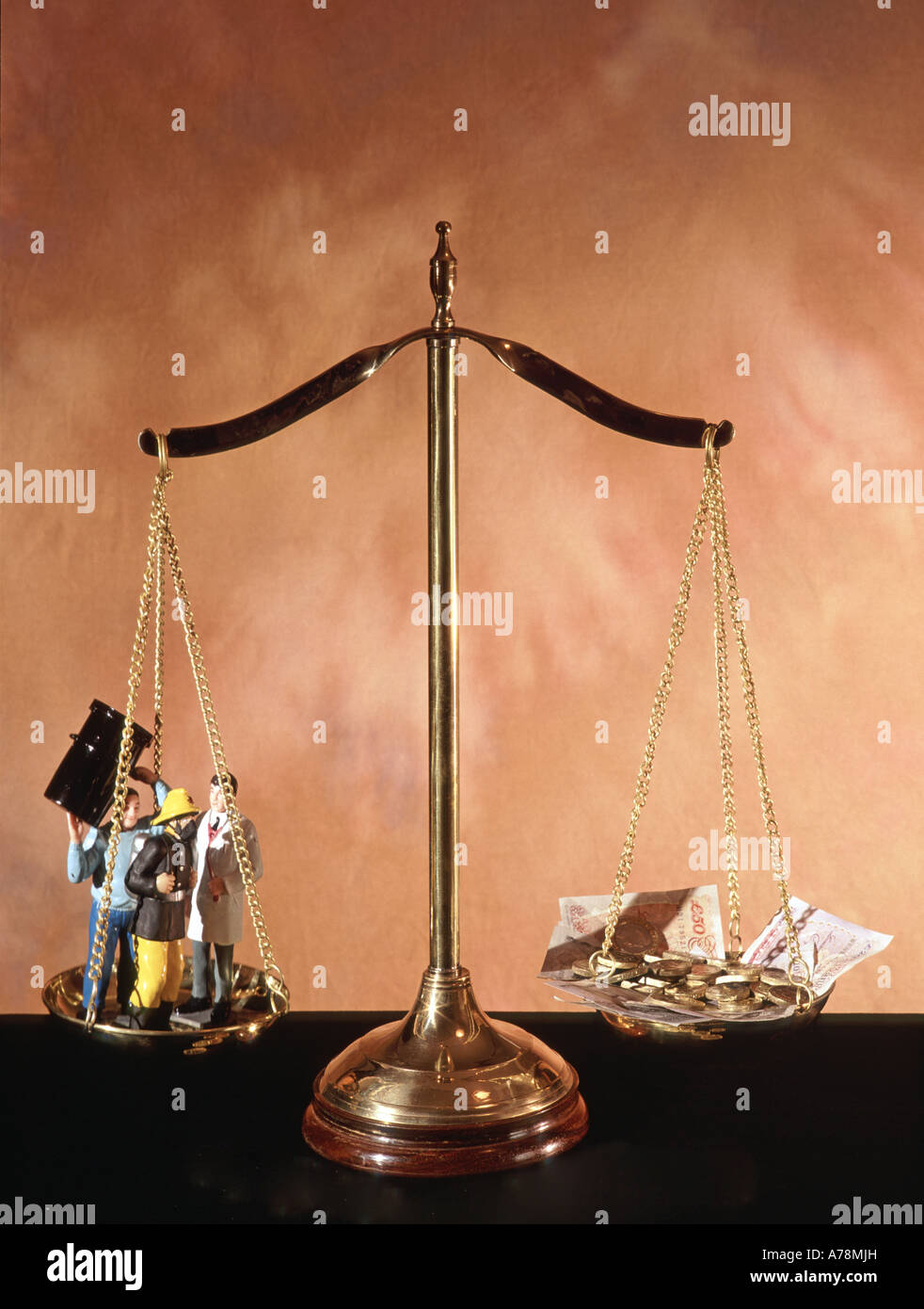 Pan balance set up as a concept image to illustrate the relationship between better public services against tax Stock Photo