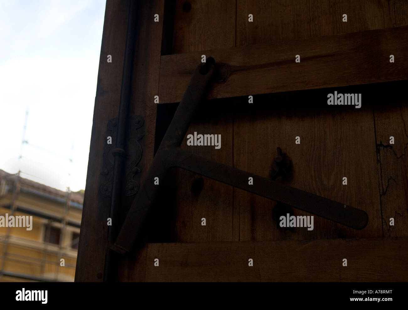 Back of a wooden door entrance to a defensive structure in Valencia. - Stock Image