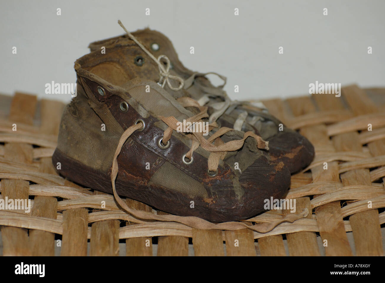 Very old worn out pair of children s sneakers or tennis shoes - Stock Image