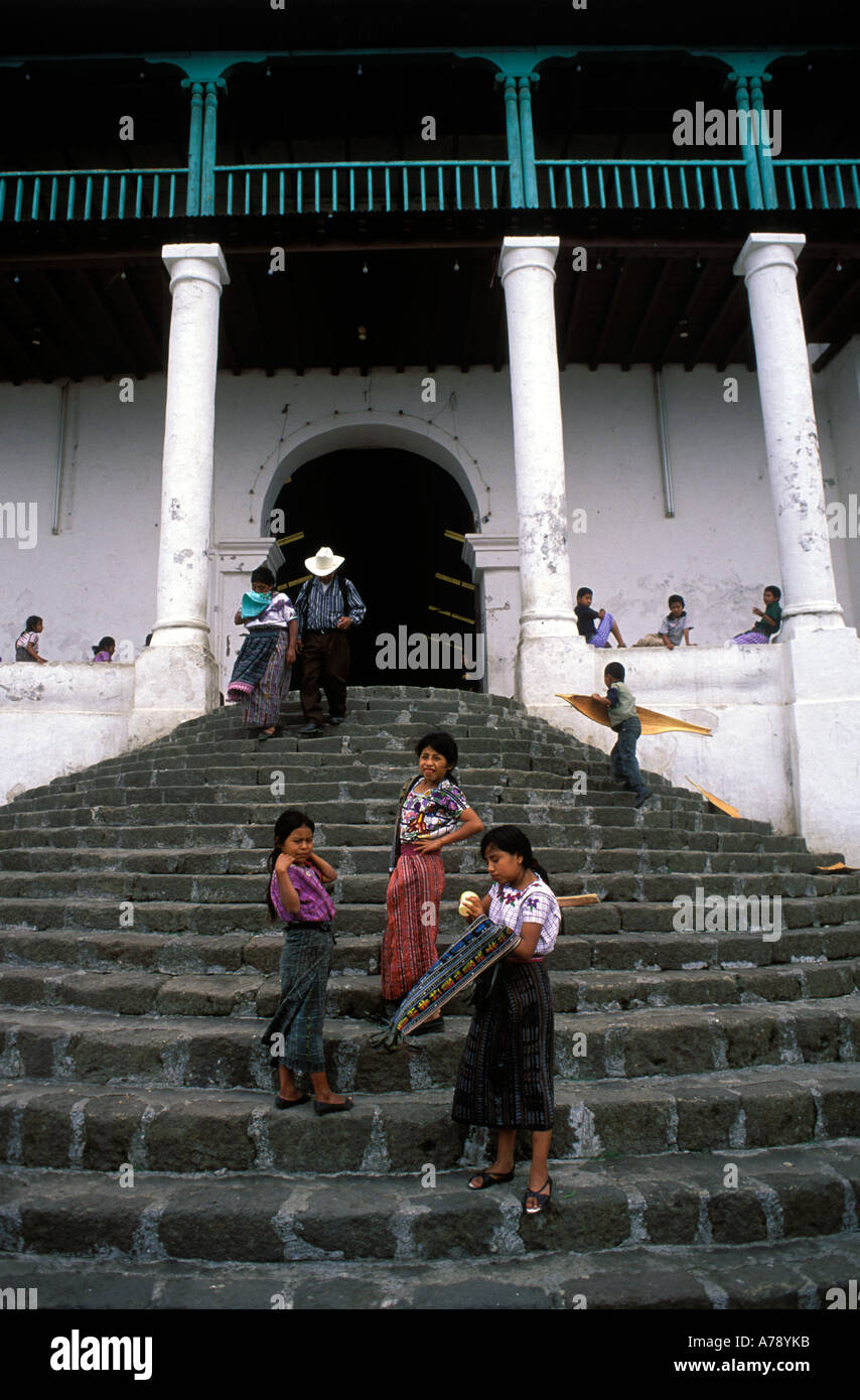 Children playing on the steps of the Catholic Church in Santiago Atitlan Guatemala. - Stock Image
