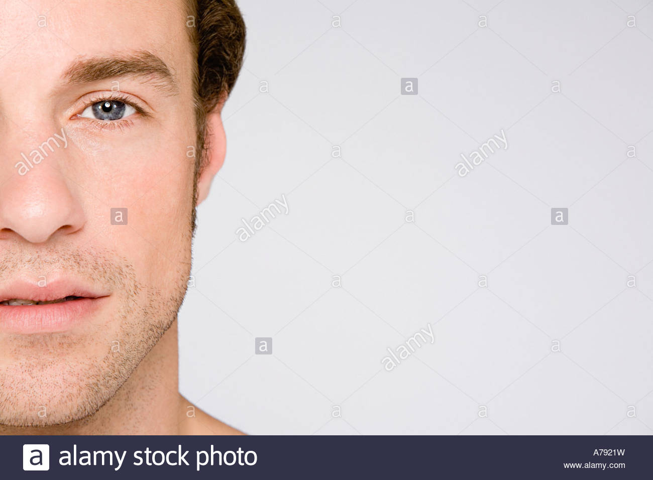 Cropped portrait of a young man - Stock Image