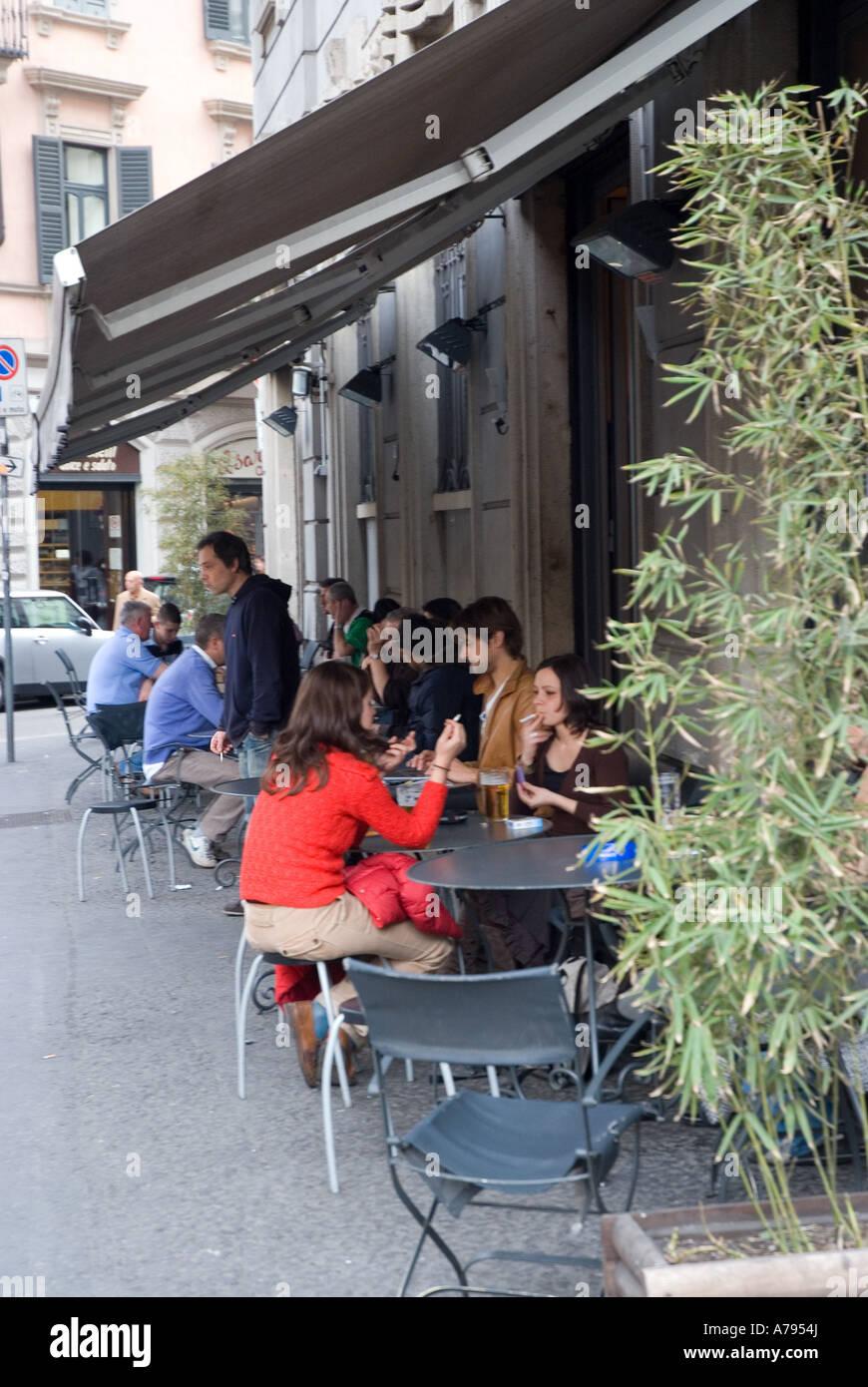 students drinking aperitif in bar magenta milano - Stock Image