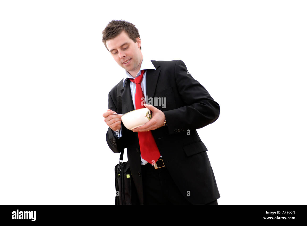 business man with late breakfast - Stock Image