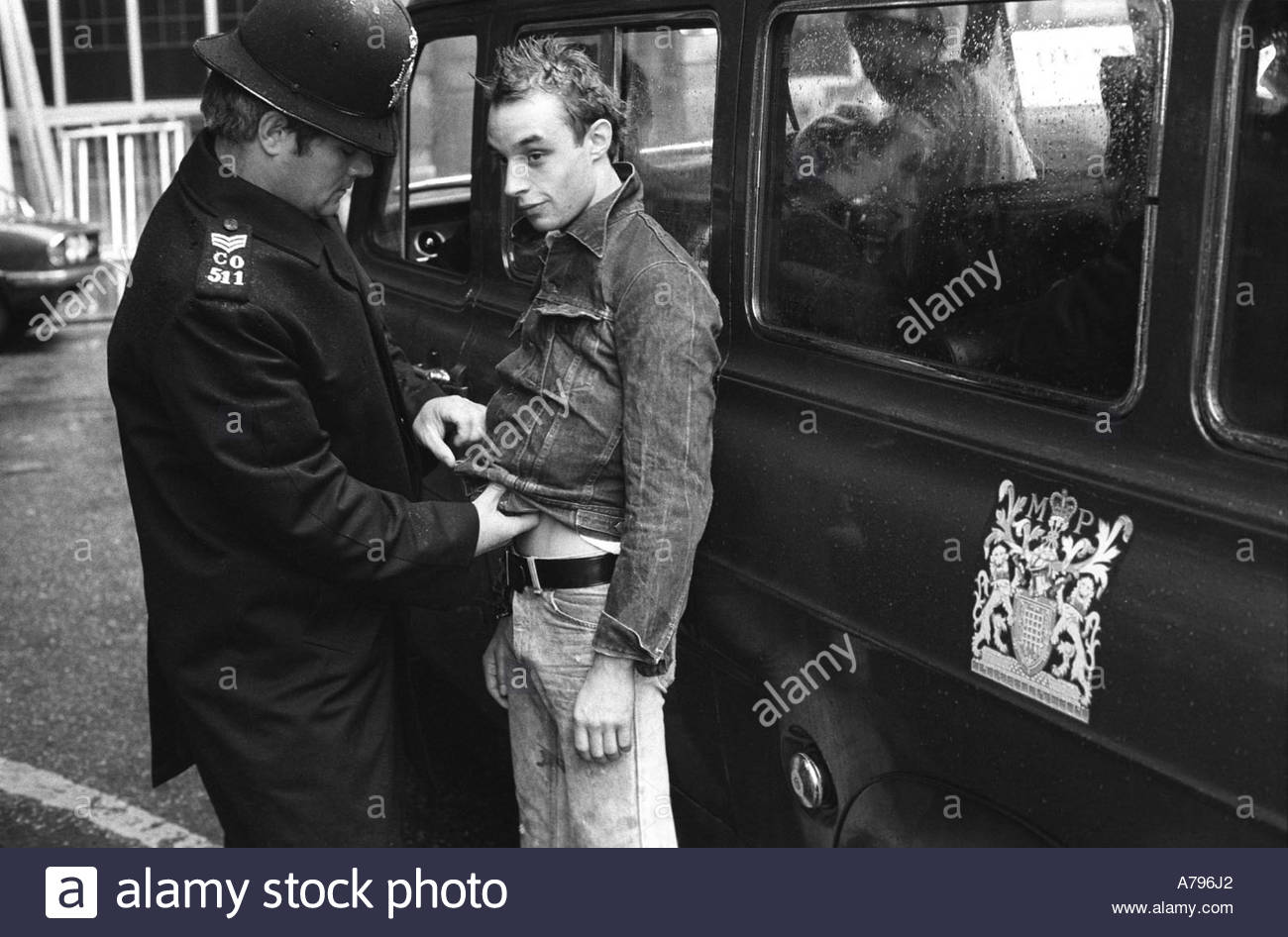 SPG Special Patrol Group  Policeman arrests, Stop  and Search a Punk in the Kings Road Chelsea  London England 1977 - Stock Image