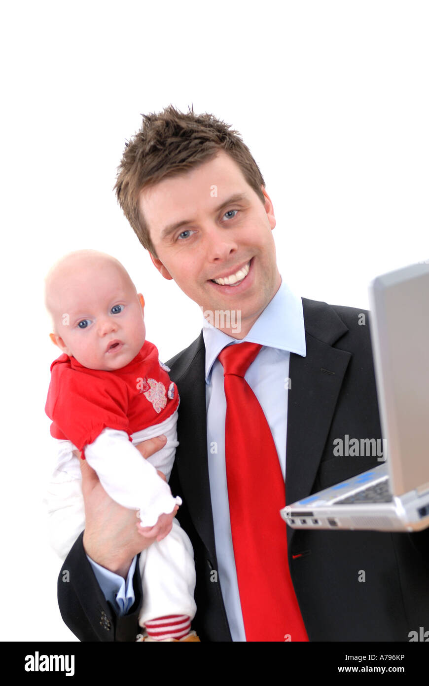 young businessman with small child baby at computer - Stock Image