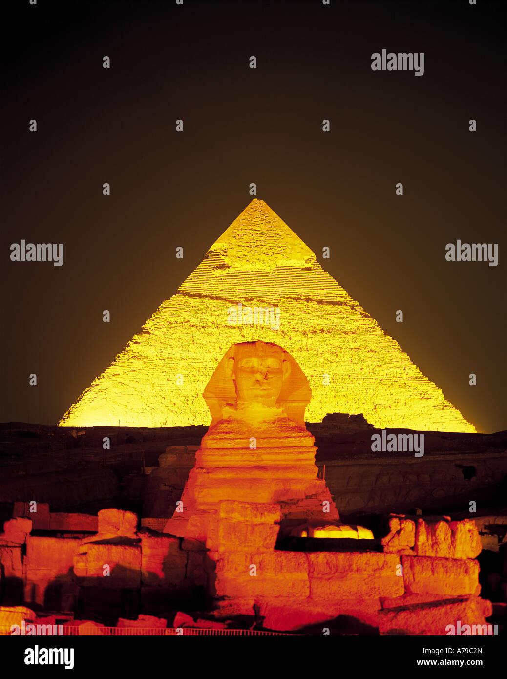 Illuminated Sphinx and Pyramid at Giza Egypt - Stock Image