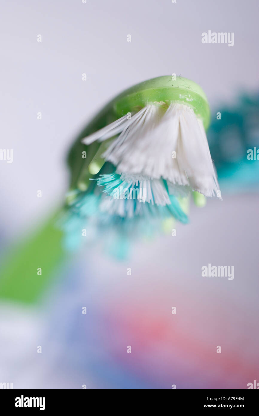 dirty badly worn toothbrushes brush worn - Stock Image