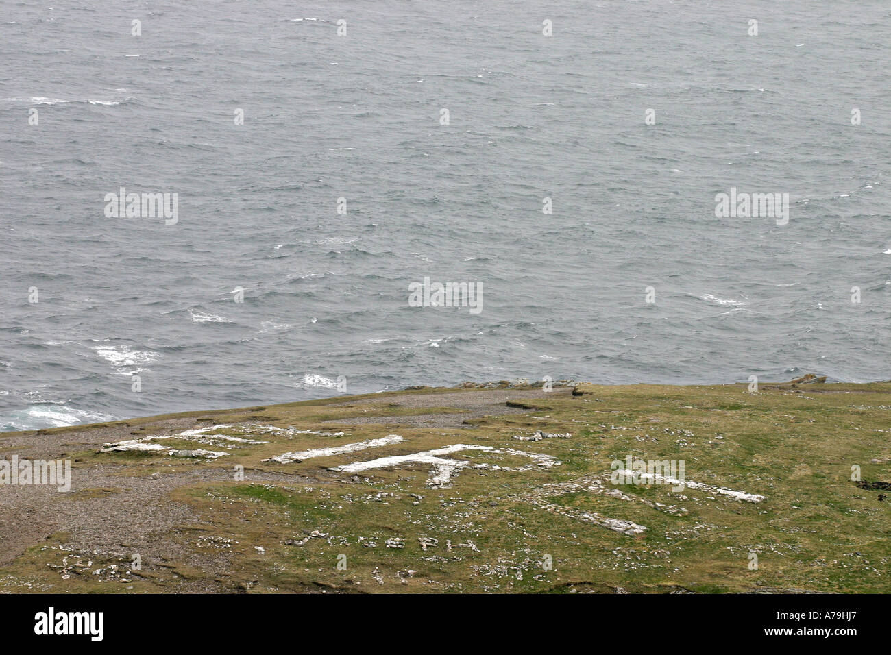 Eire: A sign that spells out Eire in rocks on a pasture on the stormy north west coast of Ireland announcing the island's name - Stock Image