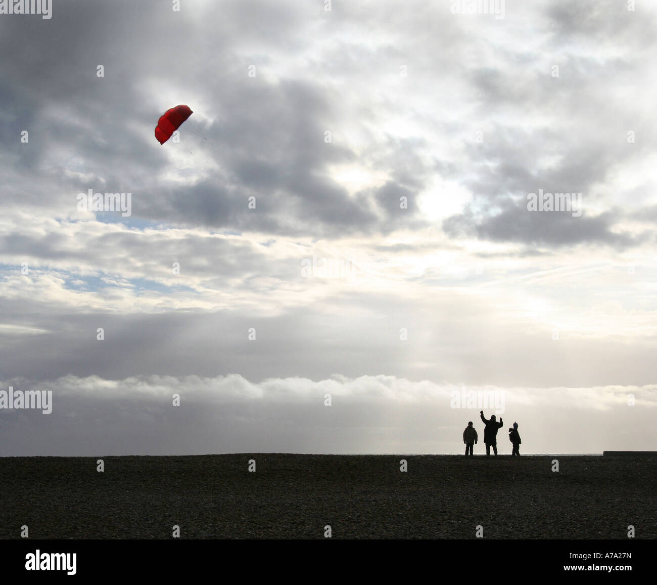 Kite flying on Brighton beach - Stock Image