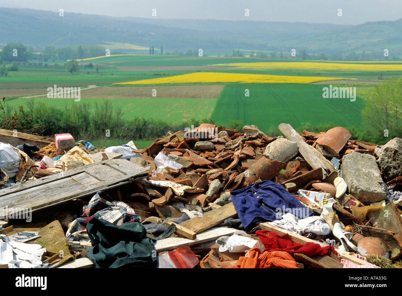 Rubbish tip / landfill site in the countryside - Stock Image