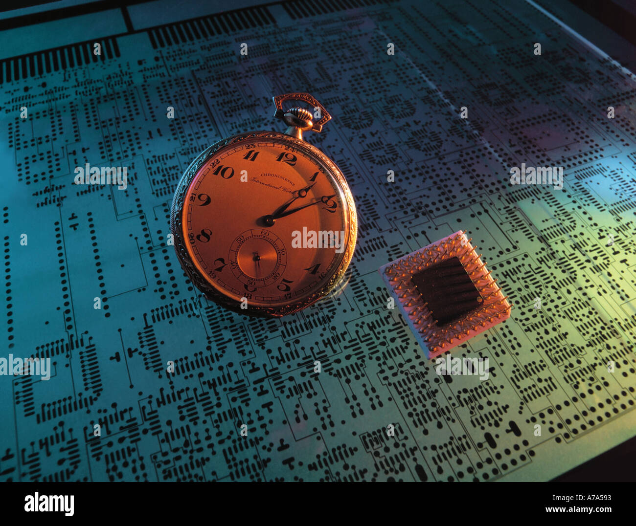 historic pocket watch micro processor layout of a circuit board motherboard - Stock Image