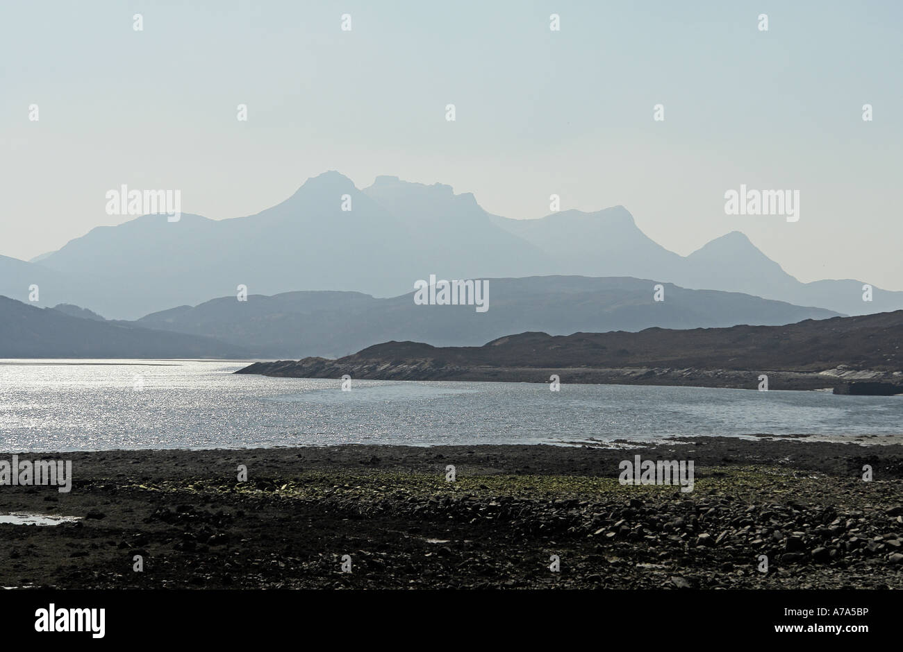 Ben Loyal in haze on a sunny spring day viewed from Achuvoldrach at causeway crossing Kyle of Tongue Sutherland - Stock Image