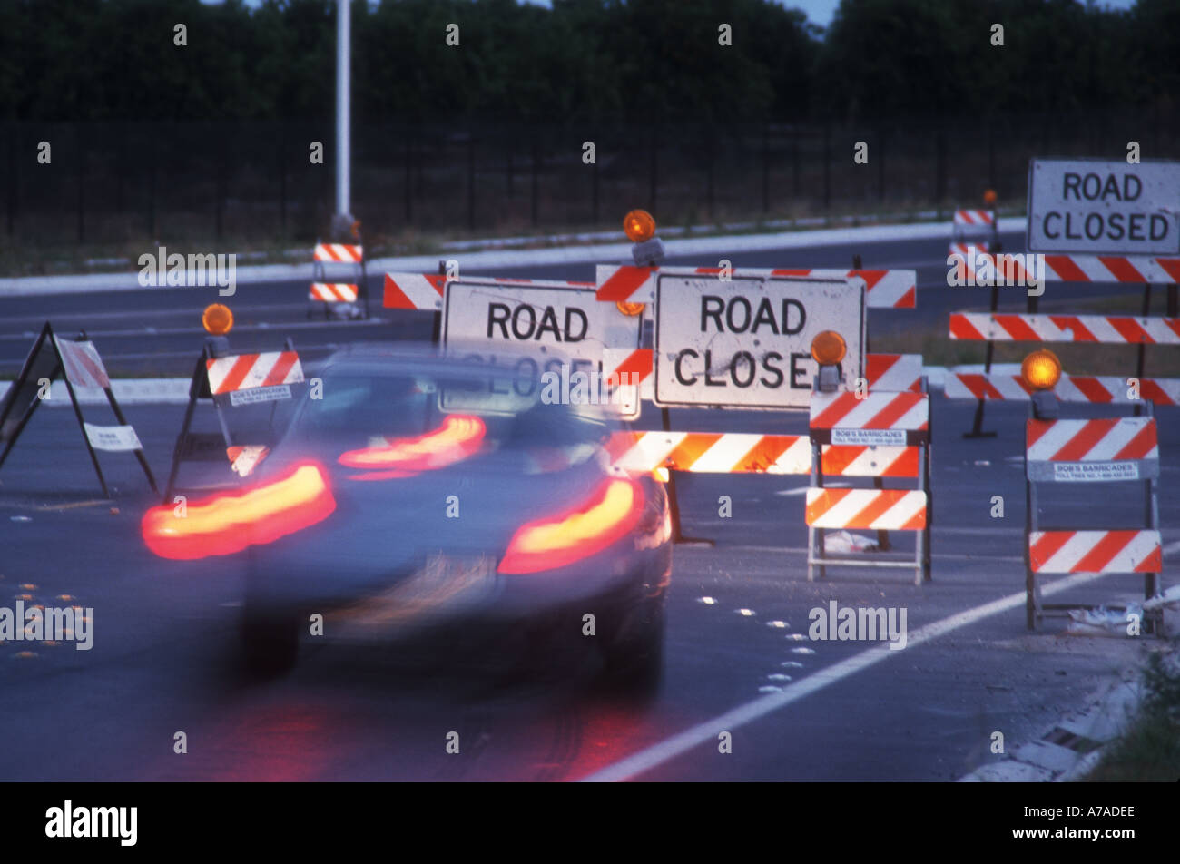 road closed with detour barricades set up with lights - Stock Image