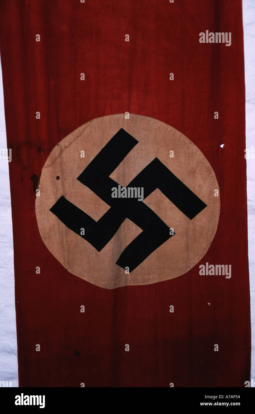 A Flag of the Third Reich Dirty and Battle Scarred - Stock Image