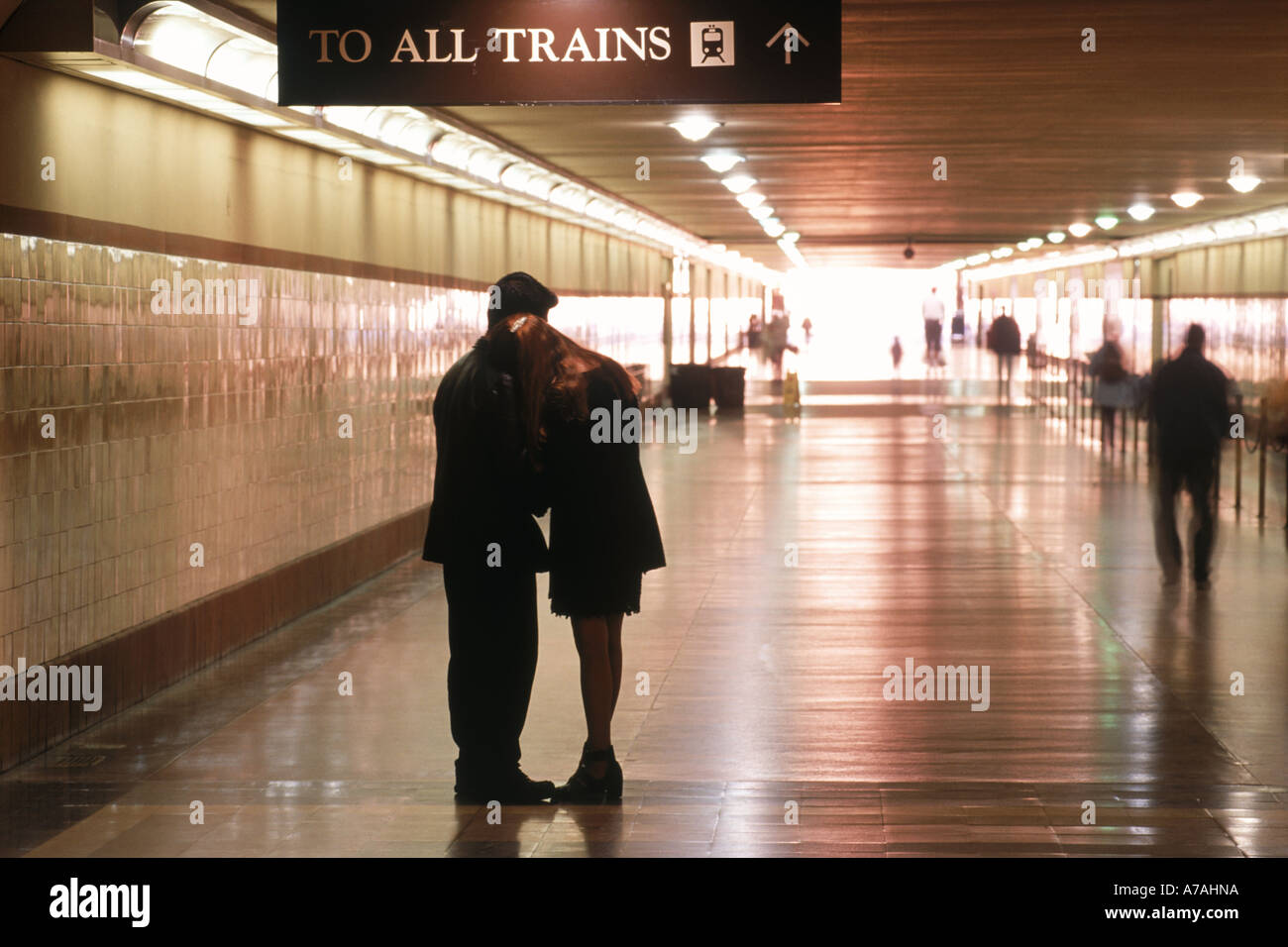 Couple saying goodbye in hallway to departing trains at Union Station in Los Angeles - Stock Image