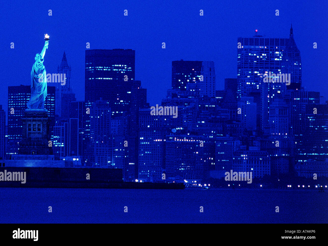 Night Time Skyline Of New York City And Statue Of Liberty Stock Photo Alamy