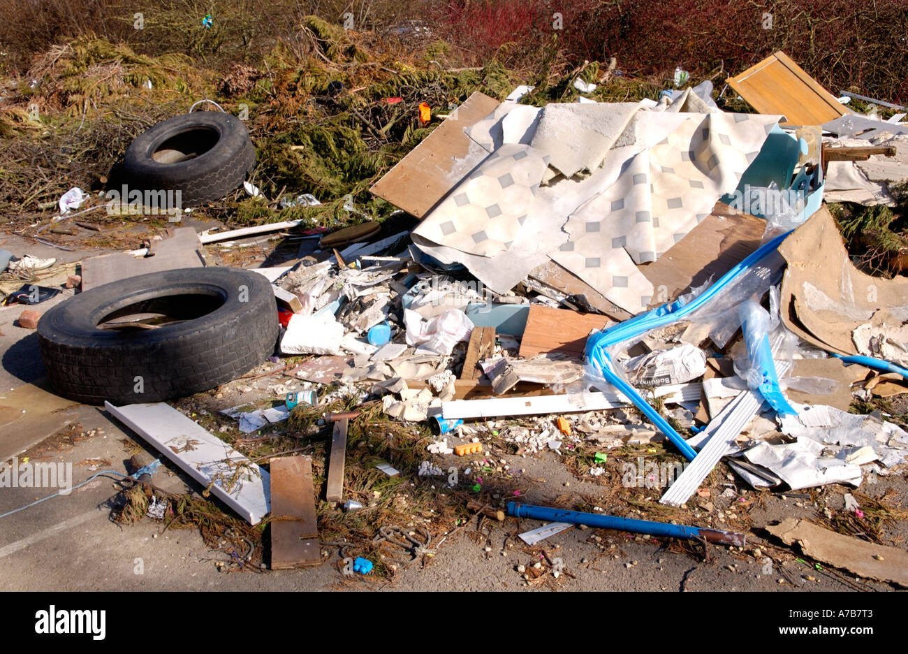 Rubbish left by caravan travellers dumped in car park of disused factory Newport South Wales UK - Stock Image