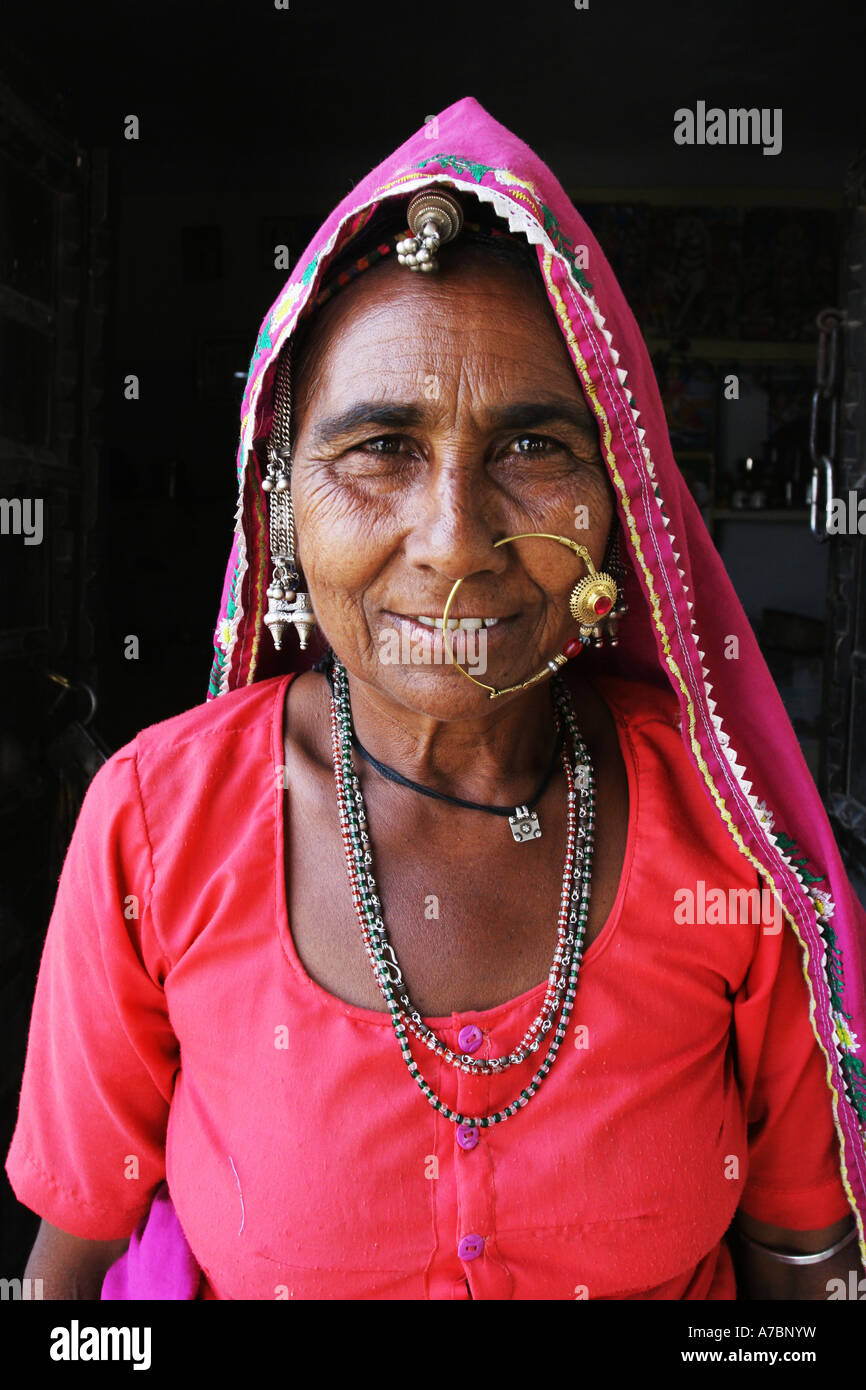 Beautiful Indian lady standing at the entrance to her house  in Pushka, India - Stock Image