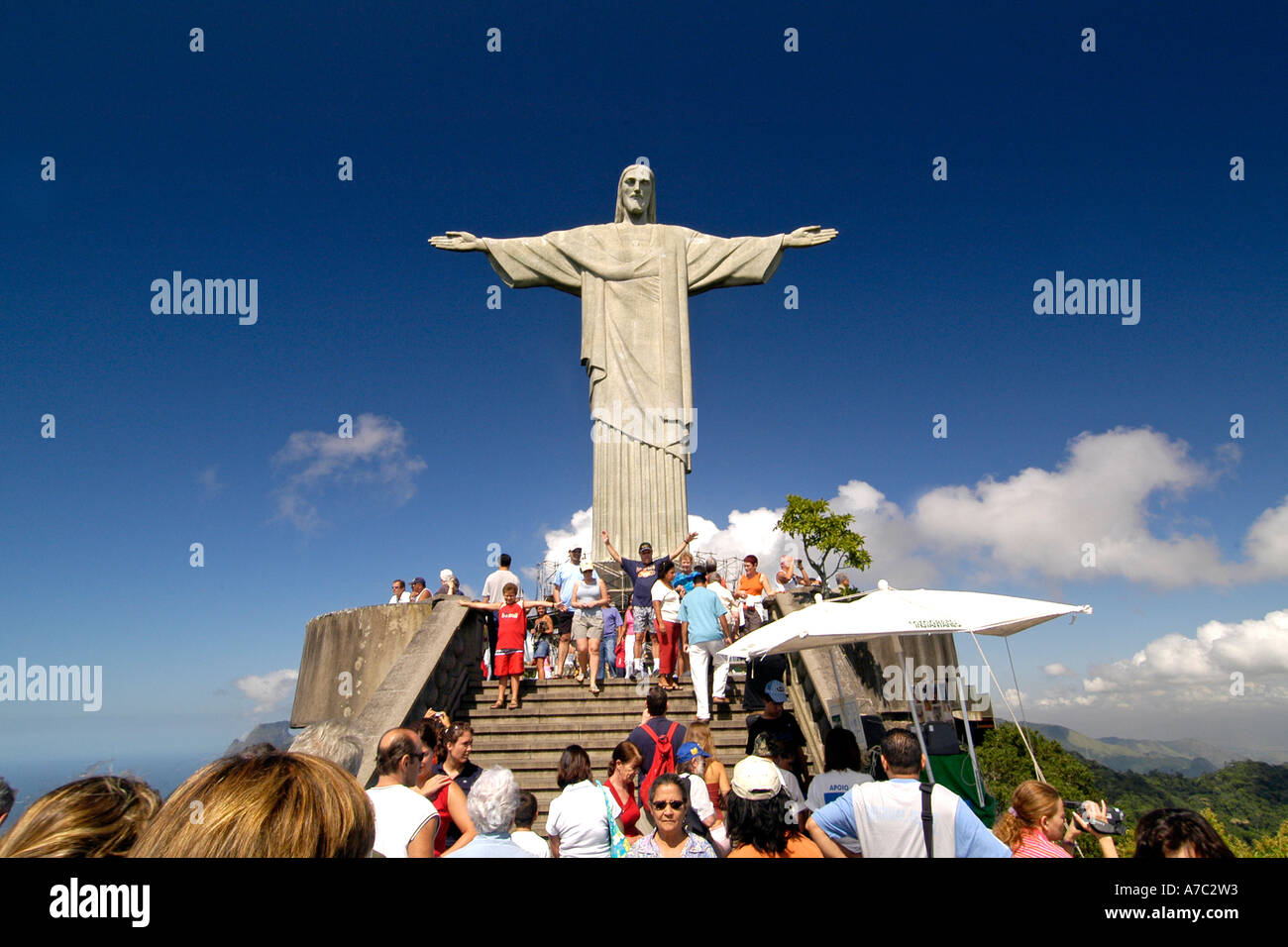 Tourists at Statue of Christ the Redeemer, Corcovado Mountain, Rio de Janeiro, Brazil - Stock Image