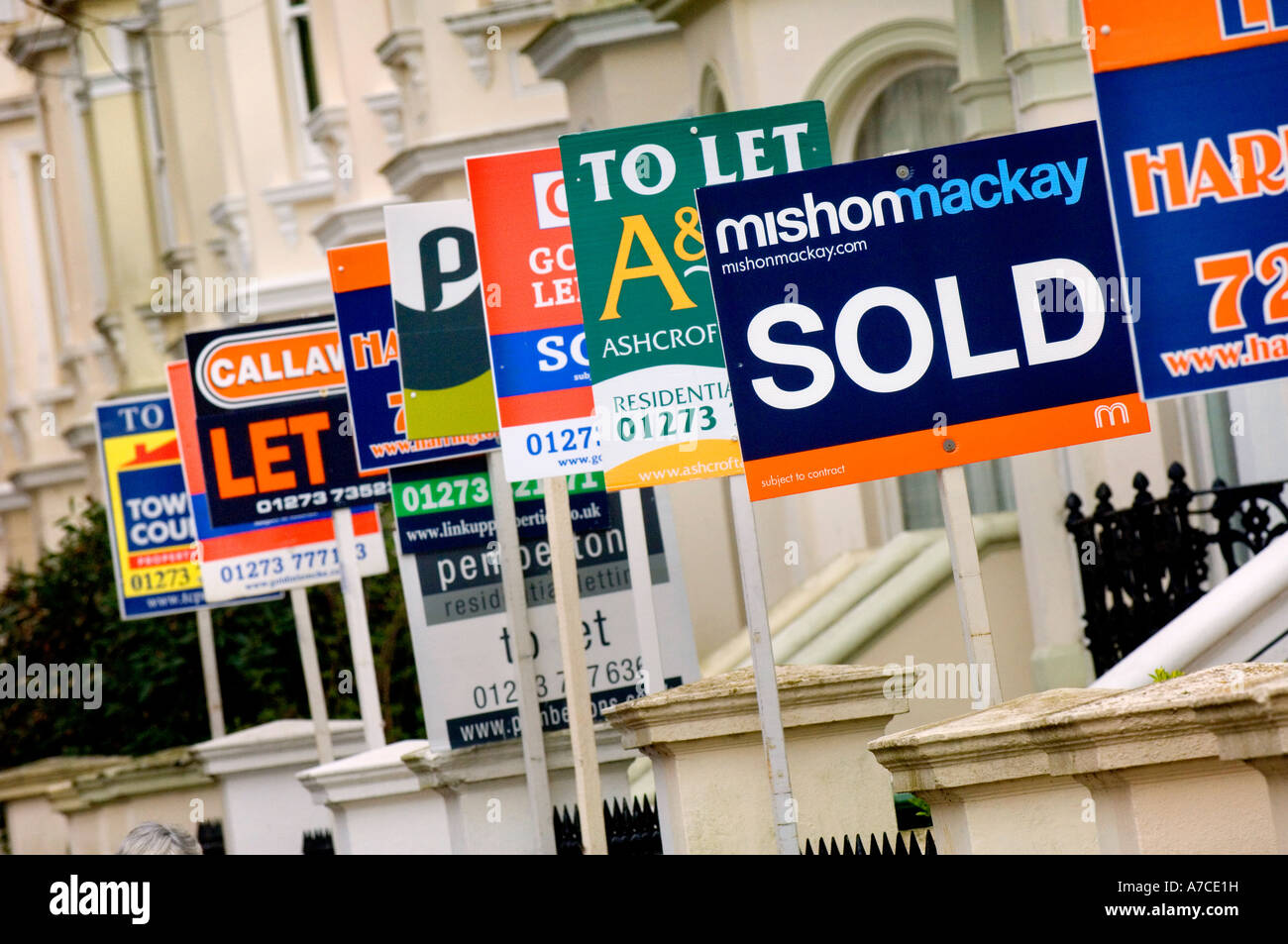 Estate agent for sale boards stacked up down a street. Picture by Jim Holden. - Stock Image