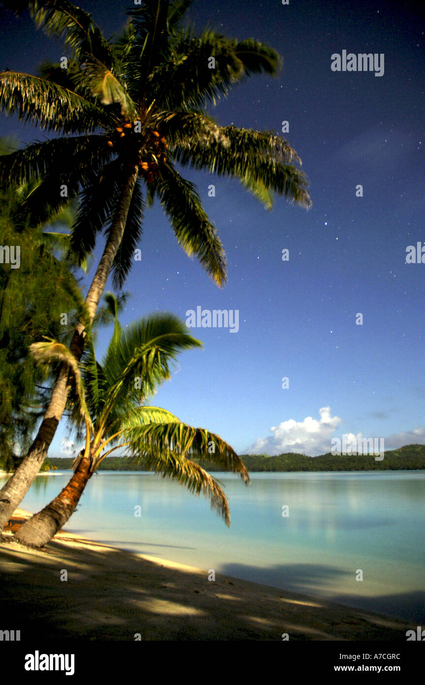 Moonshine over Aitutaki lagoon in the Cook Islands the lagoon is as beautiful by night as it is by day - Stock Image