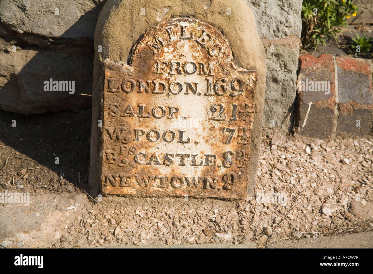 MONTGOMERY POWYS MID WALES UK April An old metal non metric milestone laid into stone in this attractive town Stock Photo