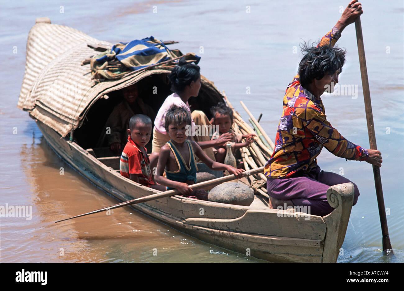 Burmese family travelling by boat Ava near Mandalay Burma - Stock Image