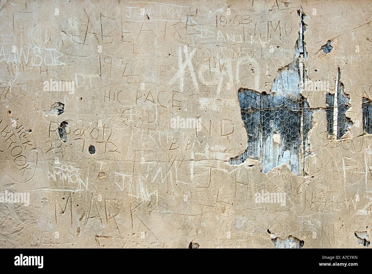 graffitti on ruins of walls - Stock Image