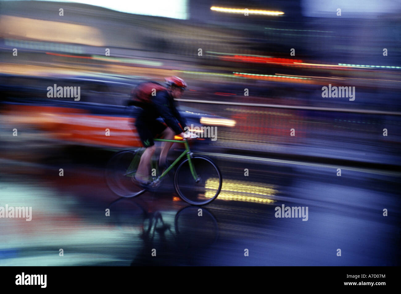 Picadilly Circus, Cyclist In The Rain, Blurred - Stock Image